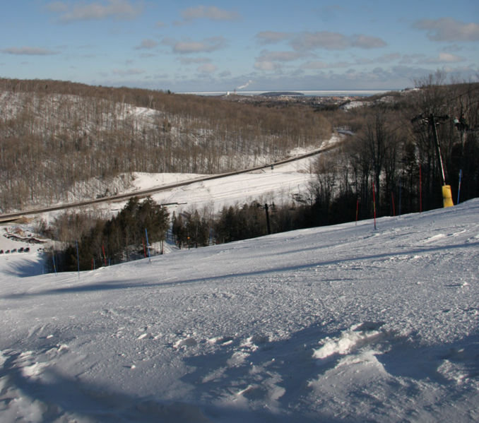 A scenic view of an open trail and run at Marquette Mountain, Michigan