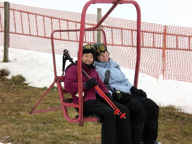 Two skiers in a chair lift at Cascade Mountain, Wisconsin