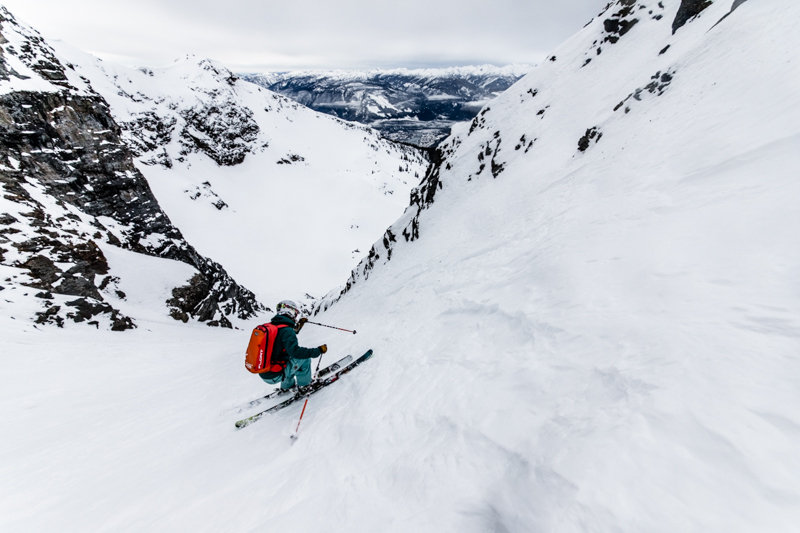 This is what 5,620 feet of vert looks like from Brown Shorts all the way to town. Skier: Amie Engerbretson. - © Liam Doran