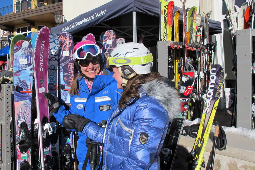Picking out the first pair of women's skis for the day during She Skis, 2014. - © Heather B. Fried