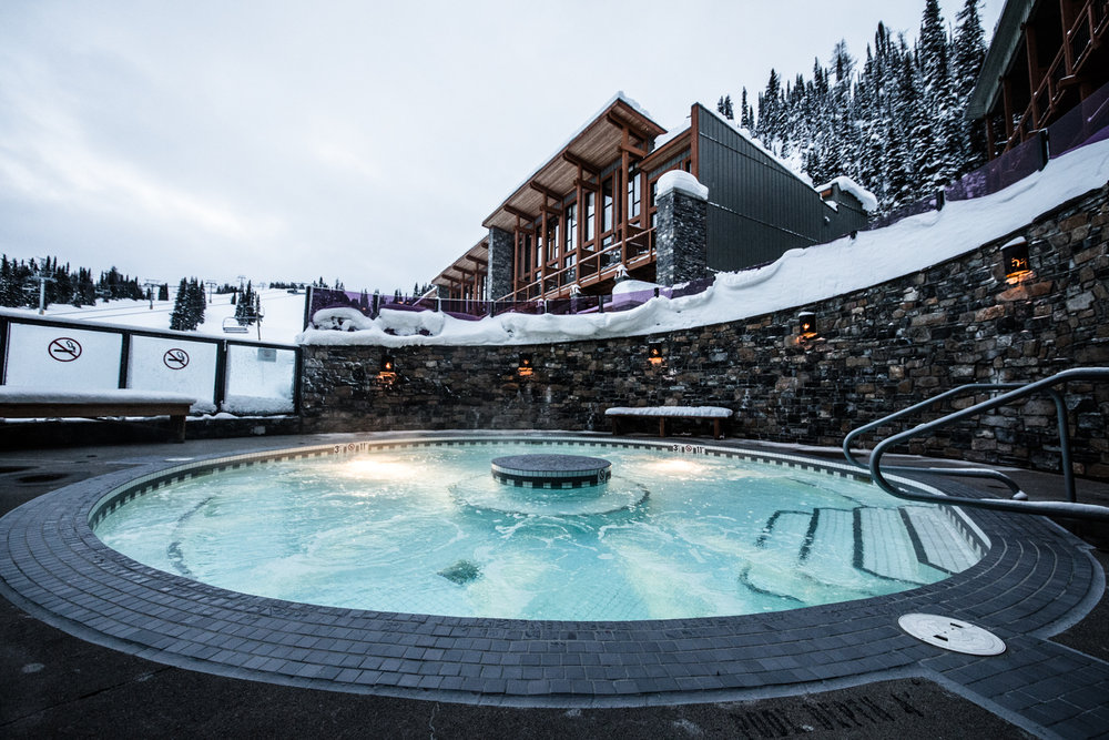 Slopeside soak, anyone? You gotta love the huge outdoor hot tub where you can relax and watch skiers go by in Sunshine Village! - © Liam Doran