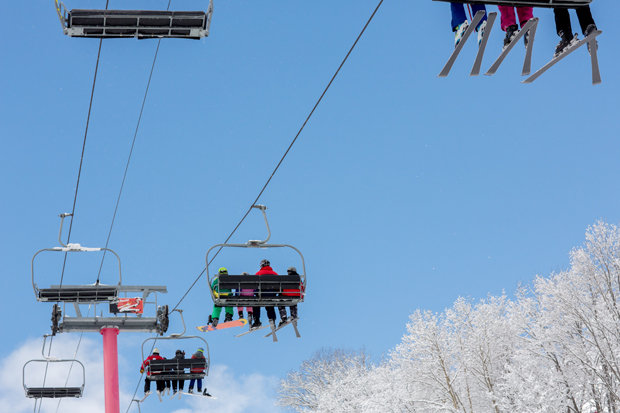 Blue sky, white trees, pink lift, at Shanty Creek - © Shanty Creek Resort