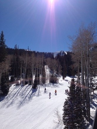 Great blue sky day. Still some good powder to be found in the trees, especially around Jupiter Bowl.