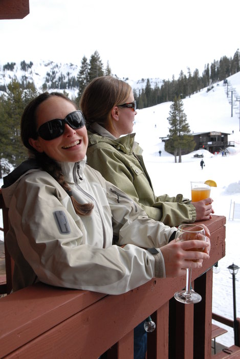 Women with apres-ski drinks at The Lodge in Aprica