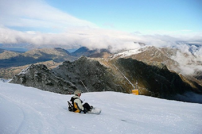 Snowboarder taking in the views at Coronet Peak, New Zealand. - ©Adrian Pua