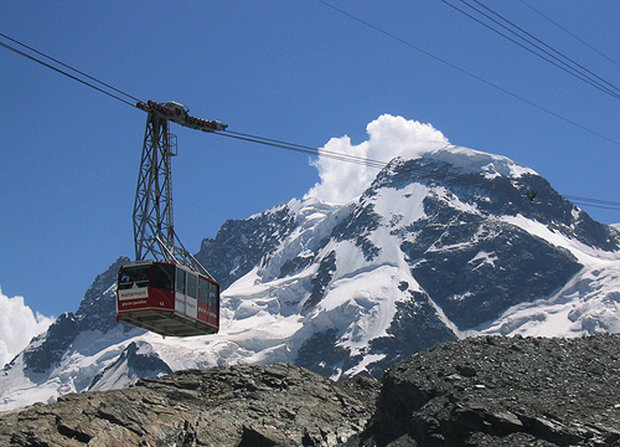 Klein Matterhorn cable car transports skiers up to the Theodul Glacier, Zermatt. - © Ollie O'Brien