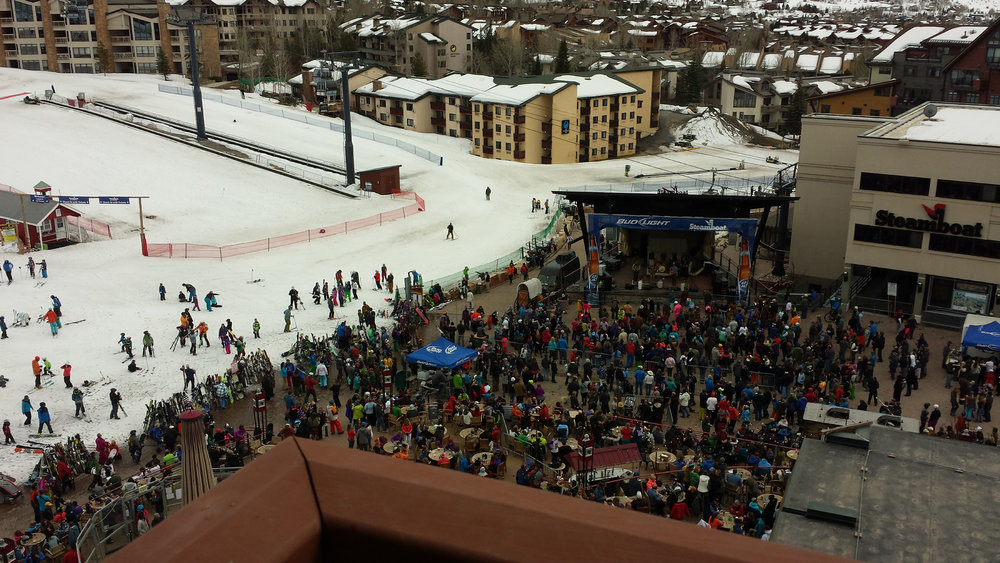 Steamboat's bustling base area, with concerts on tap all the time, is literally right below your balcony at the Sheraton. - © Heather B. Fried