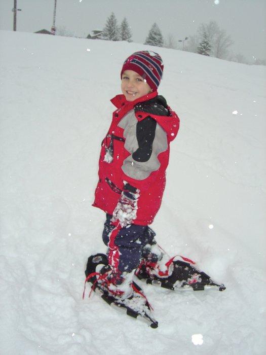 Kid snowshoeing at Treetops, MI.