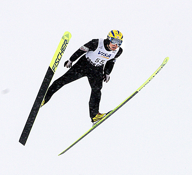 First place winner Noriaki Kasai makes winning jump.. Images from FIS World Cup ski jumping Feb. 28th, 2004. Photo courtesy Olympic Parks of Utah