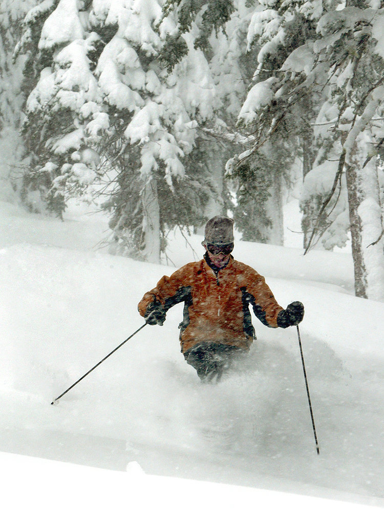 A skier deep in powder at Heavenly, CA. Dan Thrift Photography.com. Heavenly Mountain Resort 3-3-09