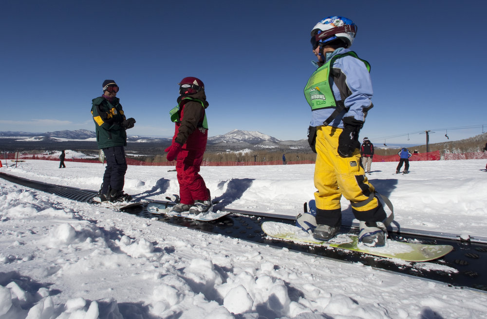 Snowboarders start out on moving carpets at Arizona Snowbowl when learning. - © Arizona Snowbowl