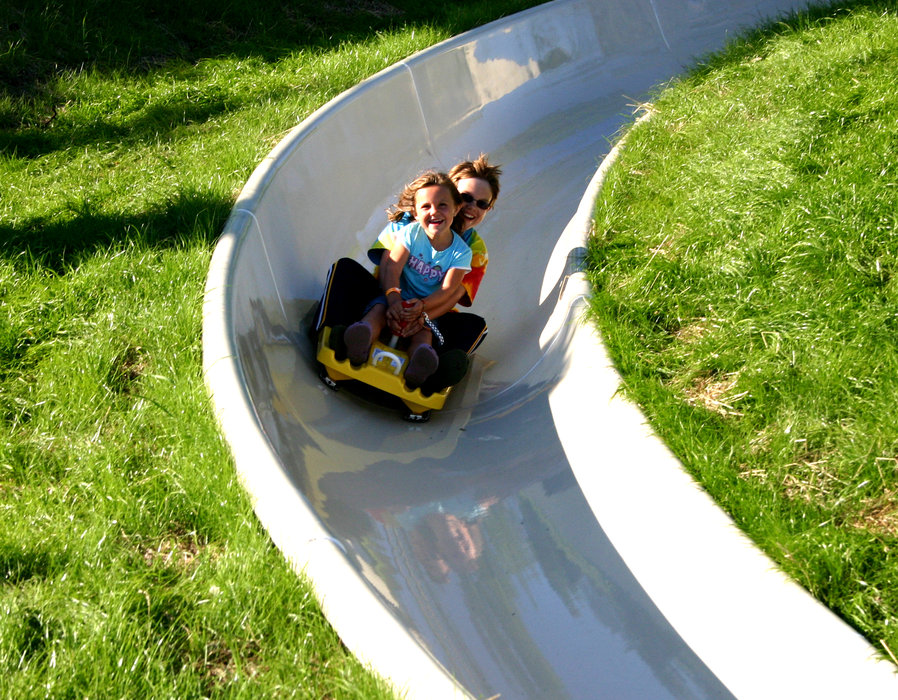 Mother and daughter descending the alpine slide at Crystal Mountain, MI.
