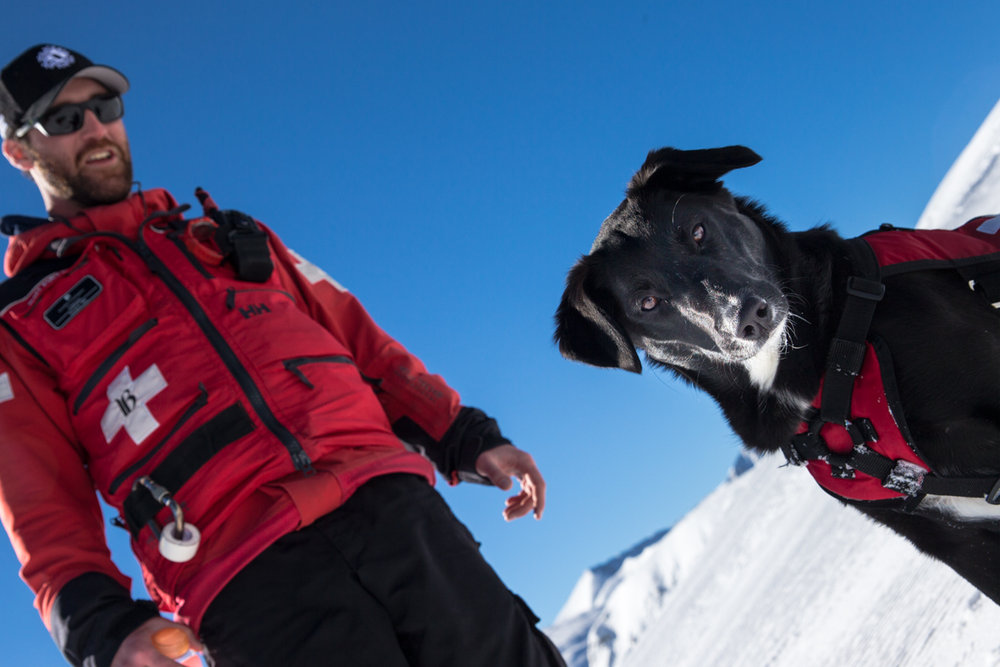 Breck ski patroller, Rob Gannon and his avy dog, Sugar out enjoying the day. - © Liam Doran