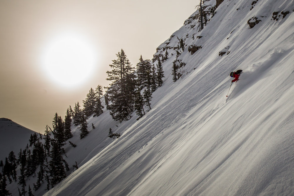 The very important job of keeping skiers safe is not without its perks. Lindsey Fell rips some powder on her way down from the top of Peaked after all the avalanche work is complete. - © Cody Downard Photography