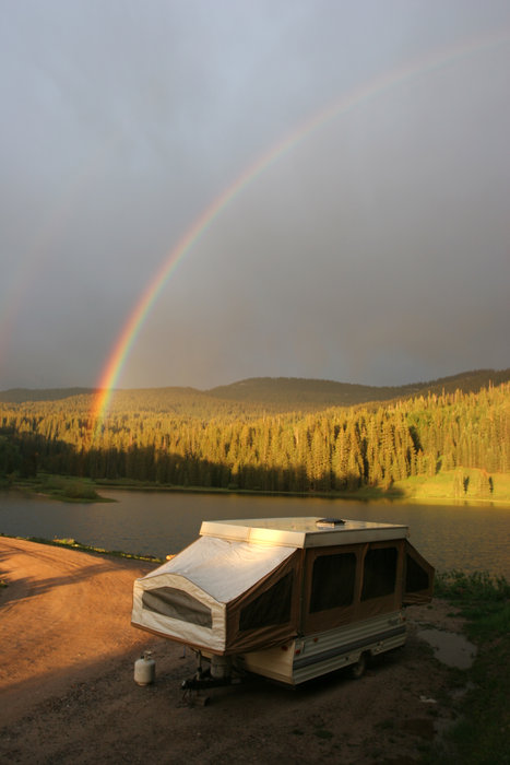 An RV parked under a rainbow in Durango.