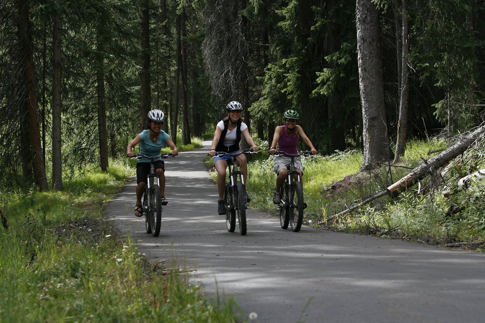 A family biking in Winter Park, CO.