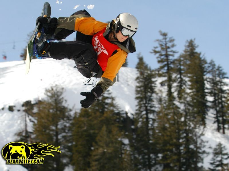 A snowboarder gets some air at Bear Valley Mountain Resort, California
