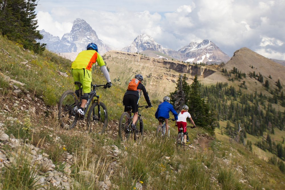 Grand Targhee mountain biking has scenic family-friendly trails and technical downhill trails with views of Grand Teton. - © Grand Targhee Resort