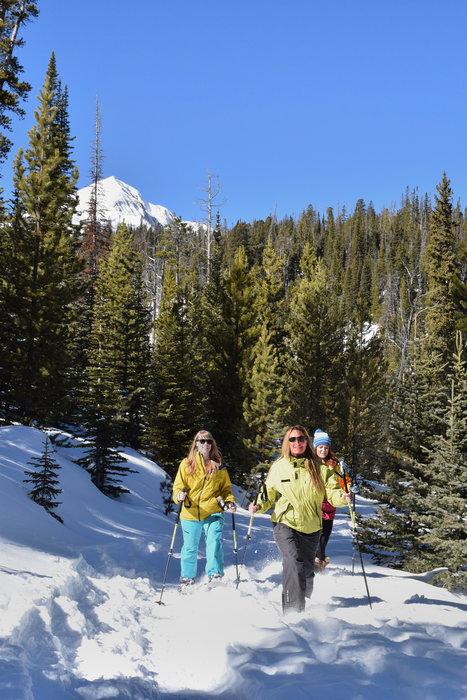 Snowshoe tours are a great way to explore Big Sky. - © Michel Tallichet