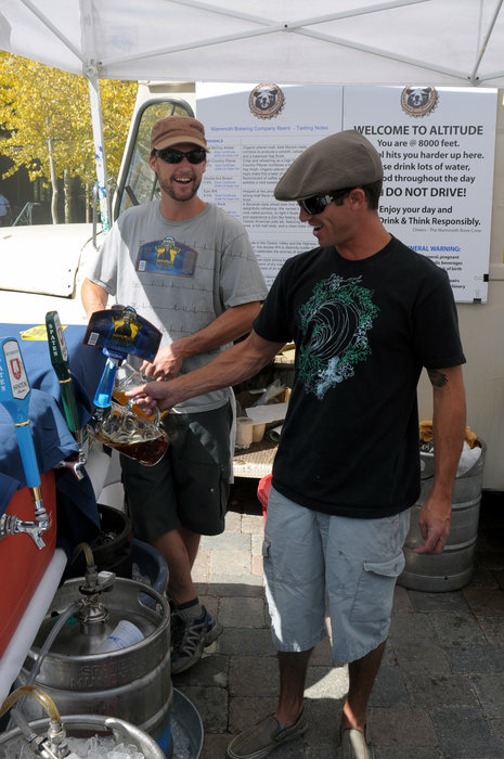 A pair of men pulling pints at Mammoth's Oktoberfest.