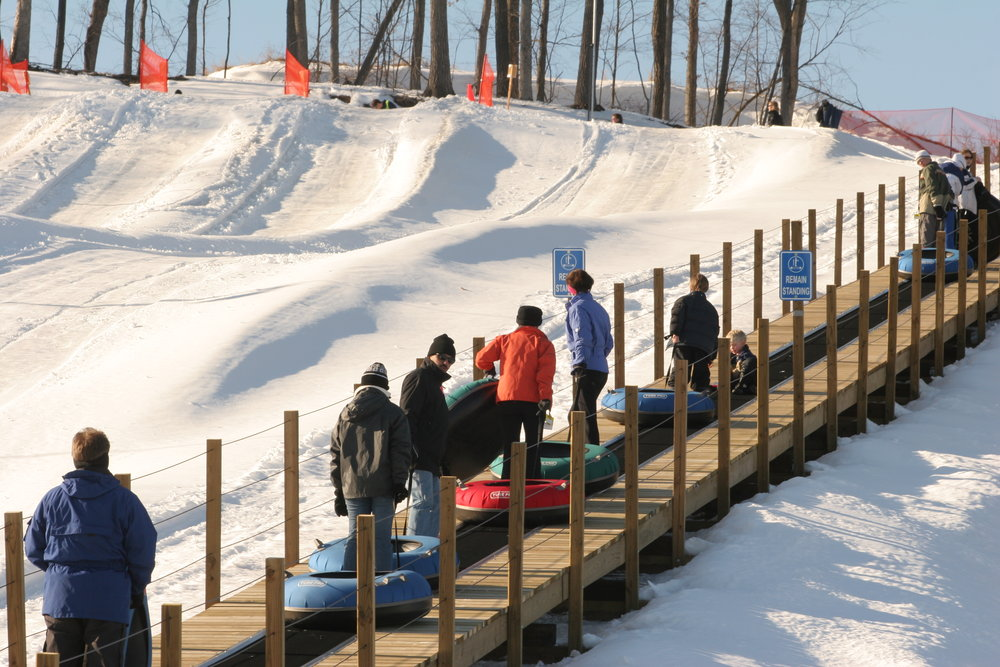 Line of tubers headed up carpet lift at Wild Mountain, MN