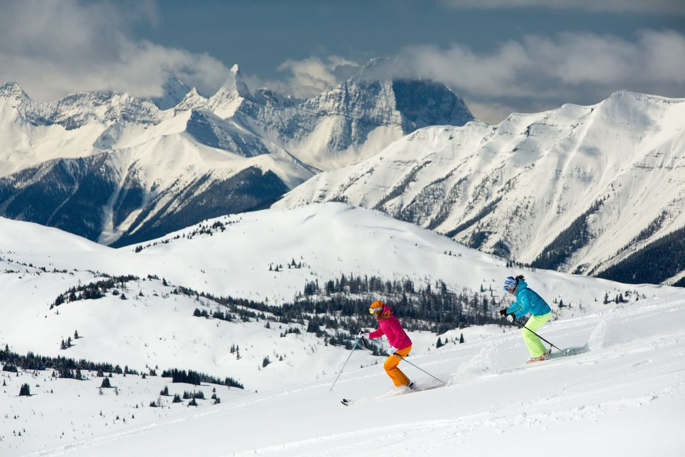 Skiers enjoy sunny slopes at Sunshine Village in Banff National Park. - © Paul Zizka/Sunshine Village