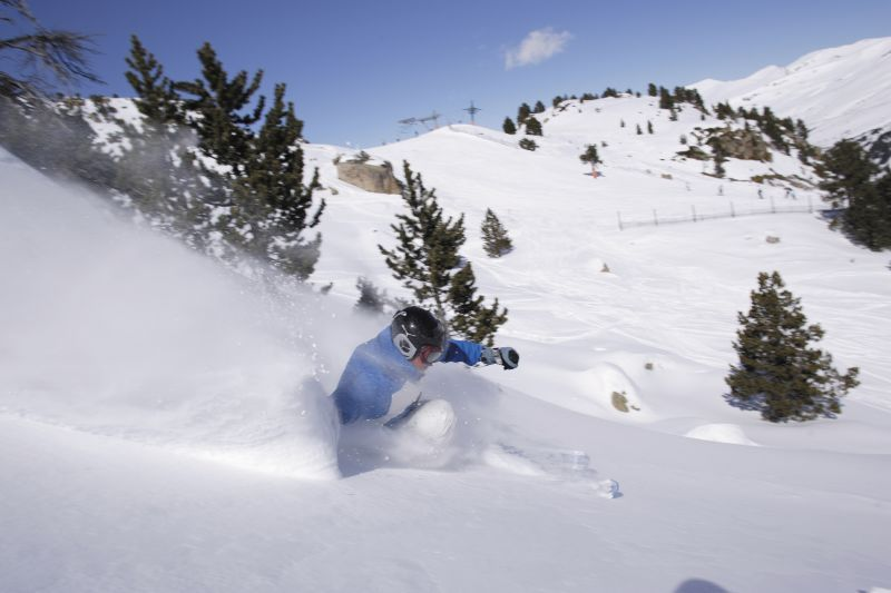 A skier sinks into powder at Grandvalira Andorra