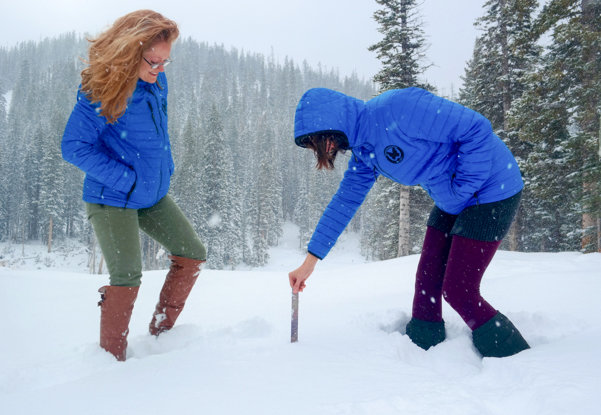 Hope and Eva at Monarch Mountain checking out the snow depth  - © Monarch Mountain Resort