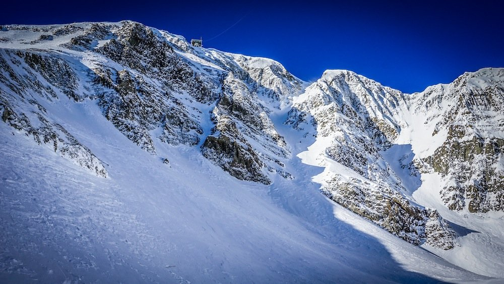 Big Couloir (skier's right) at Big Sky is a signature line that drops 1,200 vertical feet. - © Eric Slayman