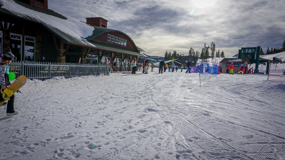 Bridger Bowl's base area begins to fill up with die hard locals. - © Eric Slayman