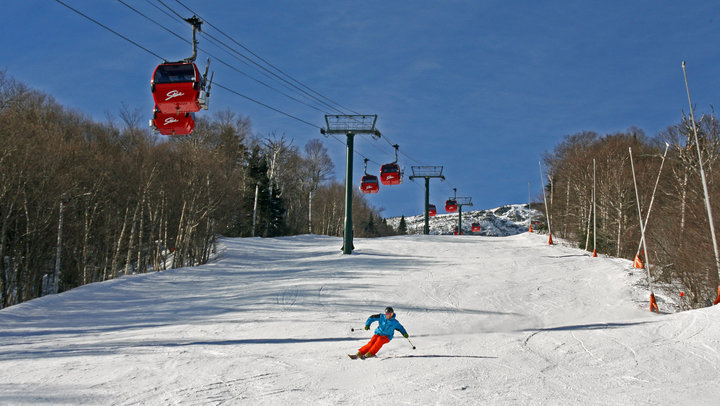 A skier descend under the gondola at Stowe. - © Spruce Park Realty LLC
