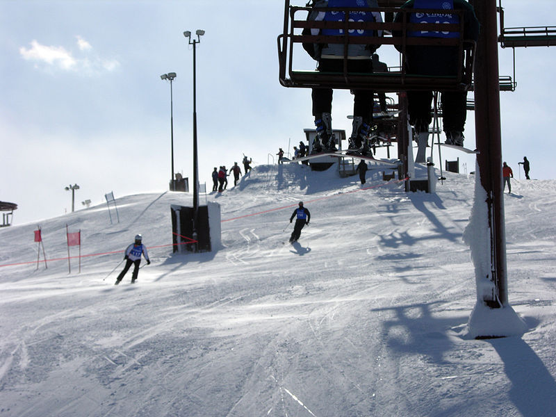 Skiers under the lifts of Wilmot Mtn, WI.