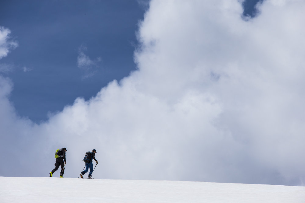 Keep your eyes on the skies while summer skiing in Rocky Mountain National Park as afternoon thunderstorms are common. - © Liam Doran