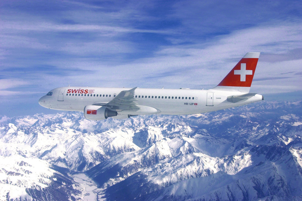 Swiss International Air Lines plane over the Alps