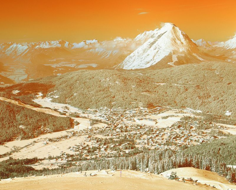 Seefeld valley resort and slopes through orange filter