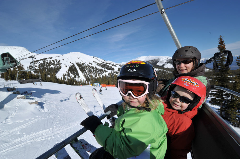 Family on chairlift at Marmot Basin, Alberta