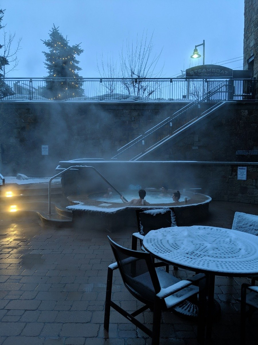 Melt into the juuuuuust-right hot tub waters at One Steamboat. - © Joan Danver