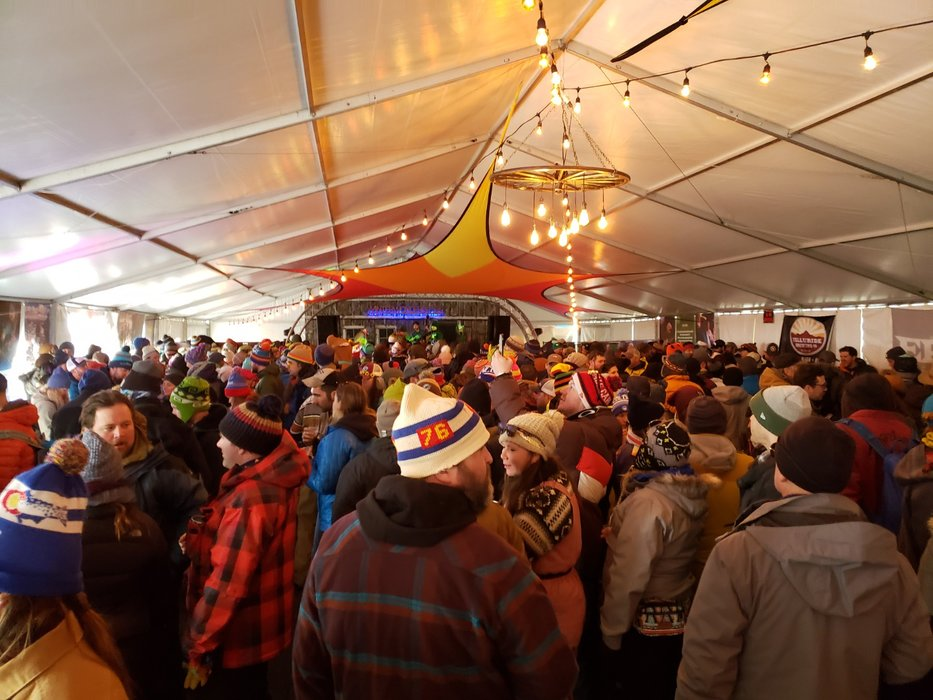 Good music in the mountains is made even better with an array of accompanying beer halls, each of which is heated and hosts a number of mini performances in-between sets on the main stage outside. - © Eric Schmidt