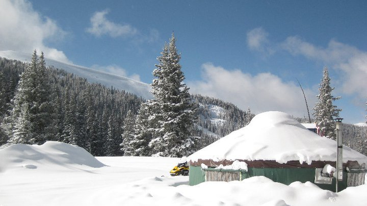 The hut covered in snow. - © Vail Powder Guides