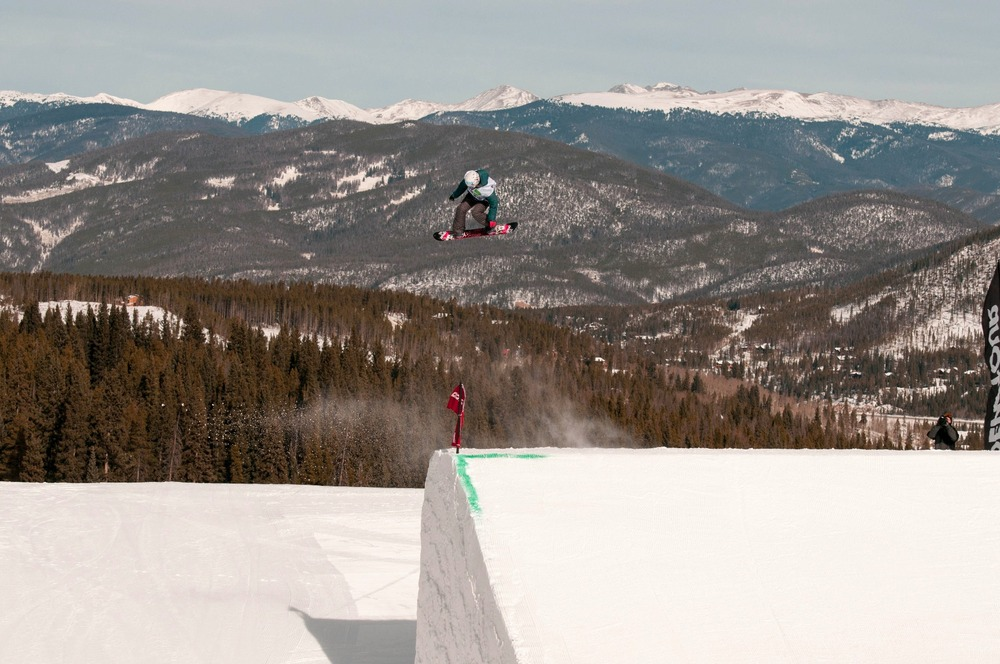 The massive, perfectly-sculpted jumps in the Dew Tour slopestyle course launched competitors high above Peak 8 terrain at Breckenridge. - © Josh Cooley