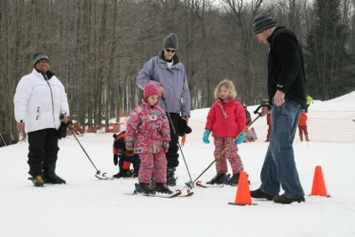 Skiers and snowboarders ages five to 12 can take advantage of special beginner pricing for lift ticket, rental and lesson. - © Timber Ridge