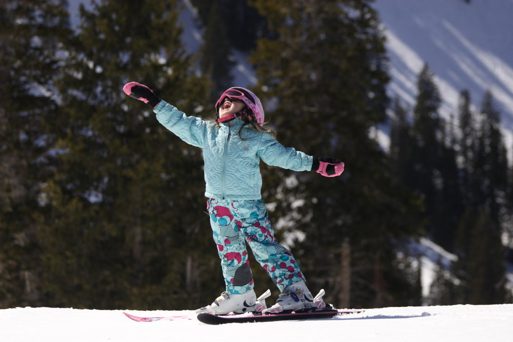 It's all smiles and sunshine when you've got a pair of skis under your feet.