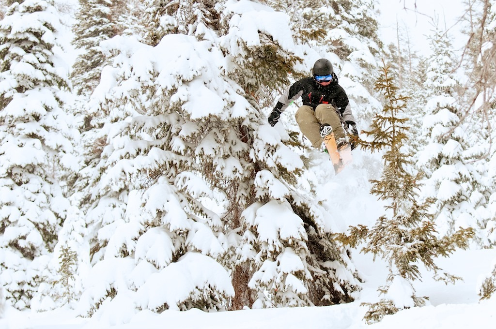 Jake Miller boosting through the trees. - © Josh Cooley