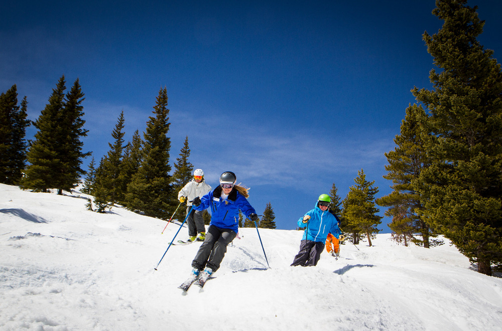 An instructor with the Winter Park Ski & Ride School leads students down a run. - © Photo Credit: Winter Park Resort