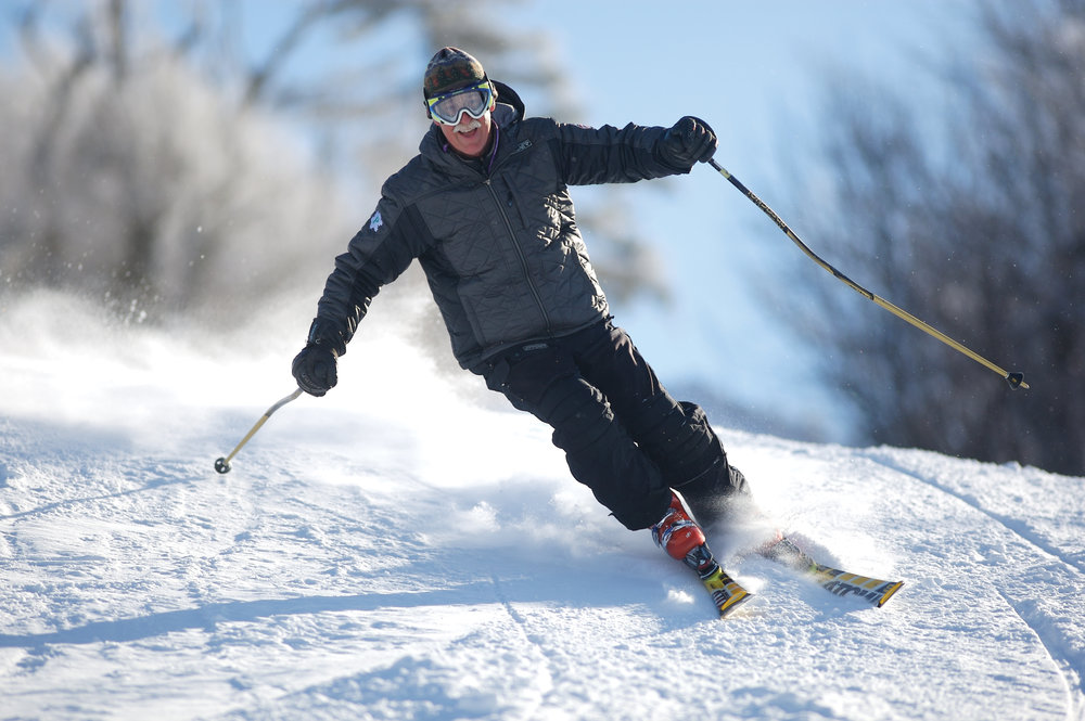 A skier at Mount Sunapee enjoys a clear day