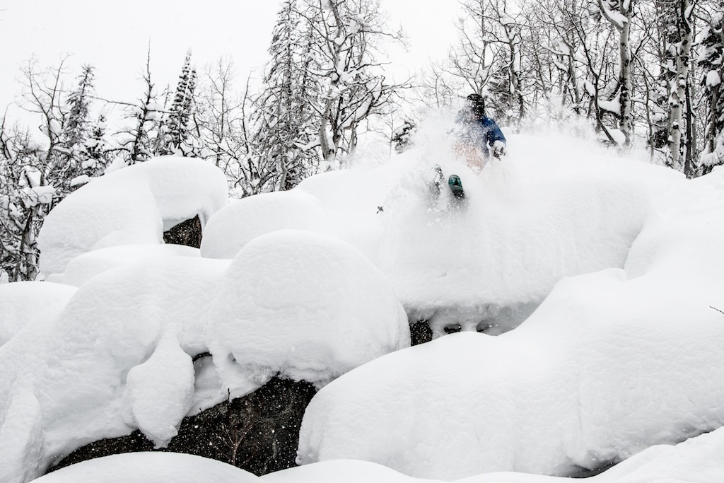 Out of the trees and into the pillows. Mike Maroney catches some air somewhere off the Thunderhead Express. - © Liam Doran