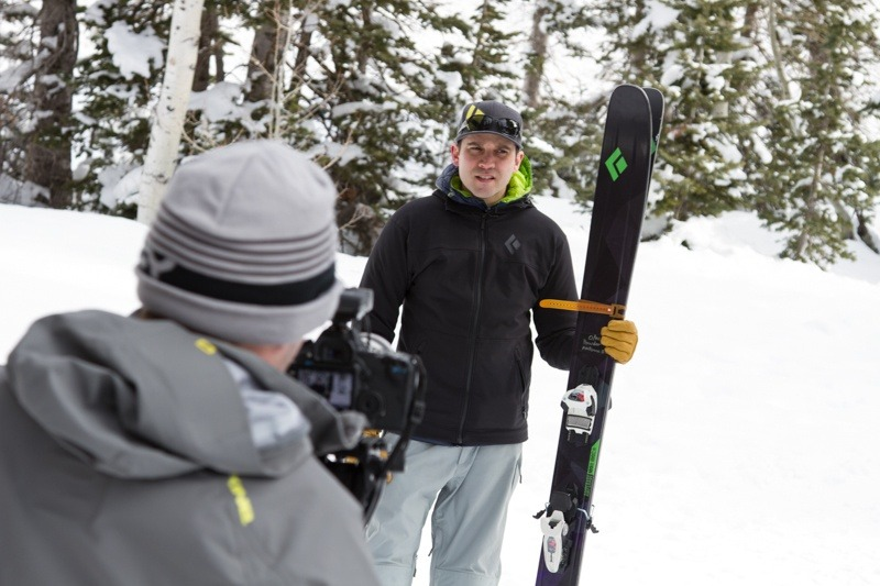 Photo/Video Editor Tim Shisler getting the run down on next year's Black Diamond skis. - © Liam Doran