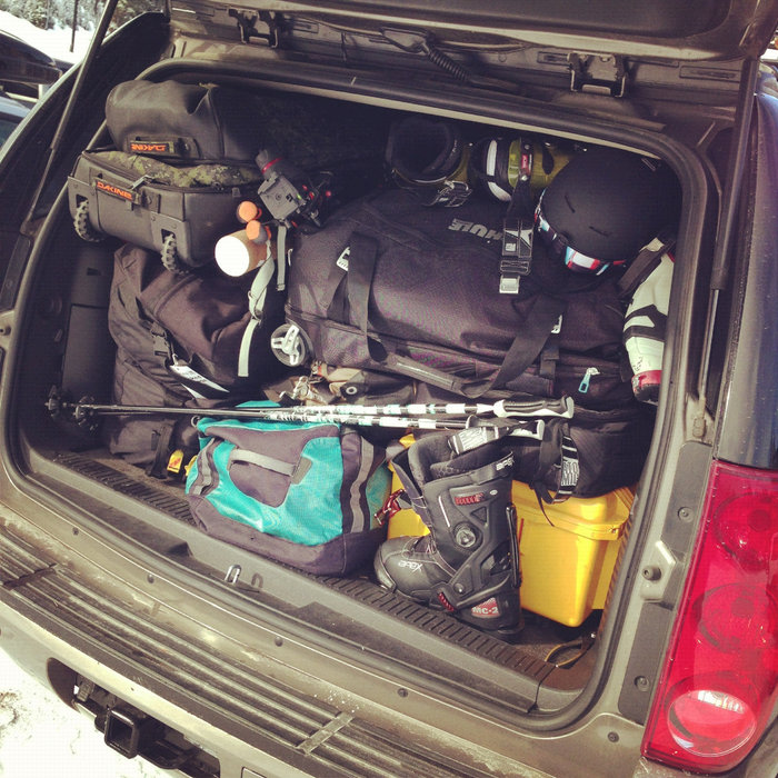 Traveling with ski gear can be tough if you plan to take a road trip. We've found it's best to put the things you'll need every day within quick reach and stash everything else. One trick is to keep a jacket, extra pair of socks and possibly a pair of pants near the seat with you. This way you won't have to dig through your bags if you need to change.  - © Tim Shisler