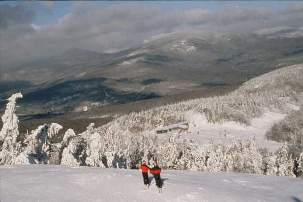 Skiers taking in the view on Sunday River, Maine's Spruce Peak