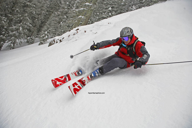 A skier makes a sharp turn down a run at Sugar Bowl Ski Resort, California